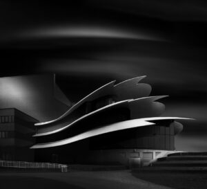 modern building with curvy roof fine art black and white