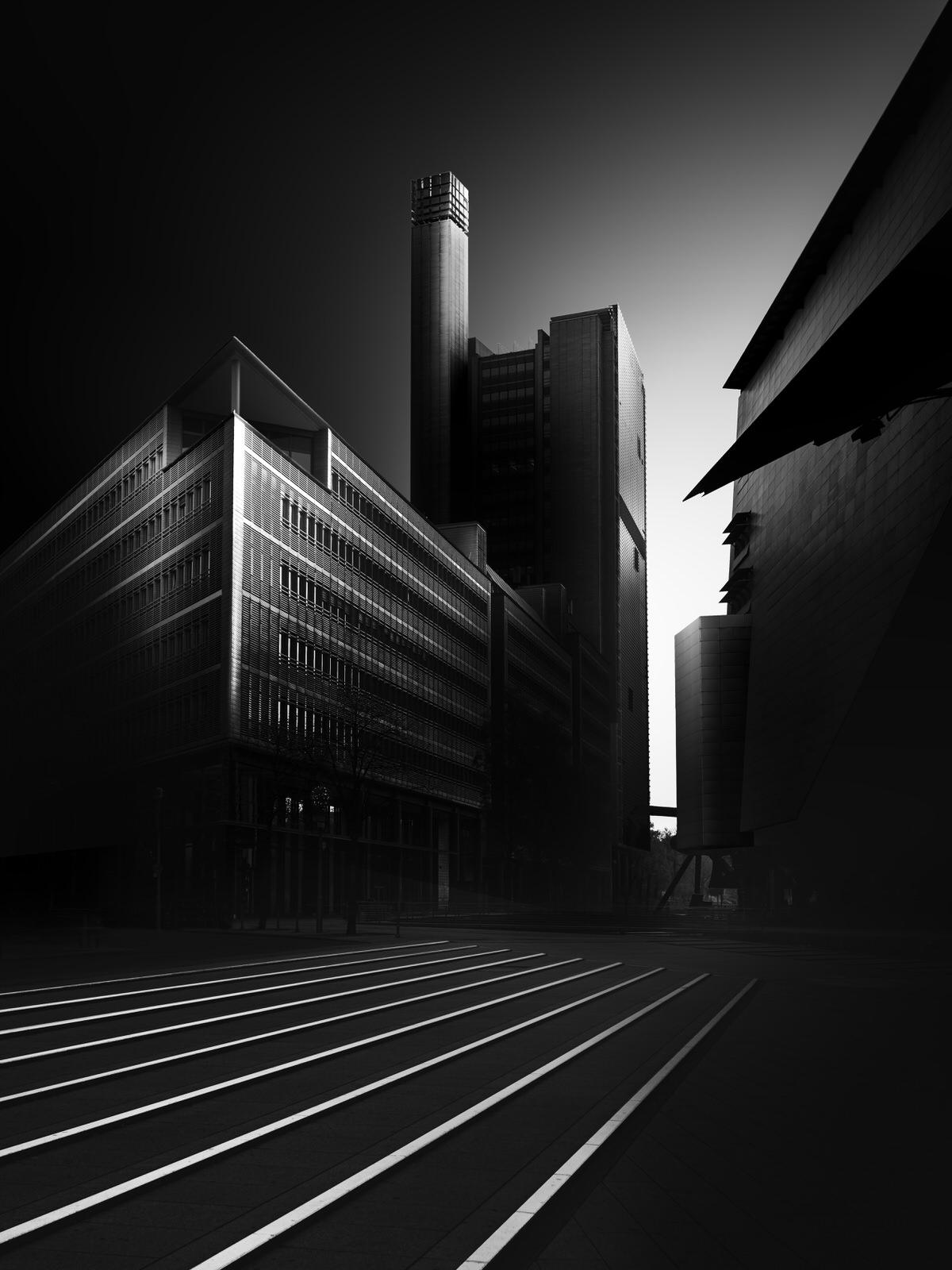 sky scraper and lines on floor fine art black and white